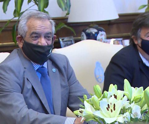 Dr. Carlos Iannizzotto con el Presidente